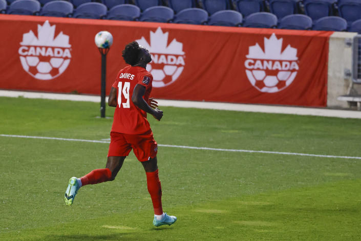 Canada's Alphonso Davies celebrates after scoring against Suriname during the first half of a World Cup 2022 Group B qualifying soccer match Tuesday, June 8, 2021, in Bridgeview, Ill. (AP Photo/Kamil Krzaczynski)
