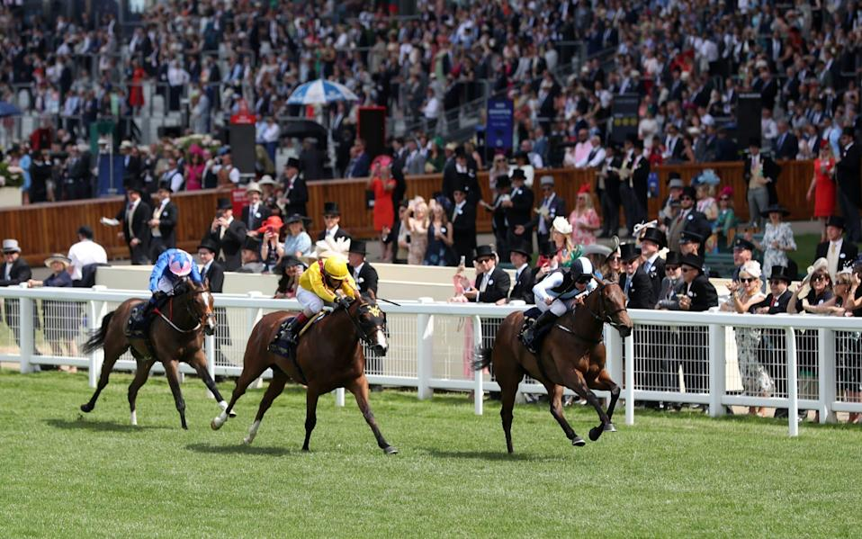 Quick Suzy and Gary Carroll (right) coming home to win the Queen Mary Stakes - PA Wire