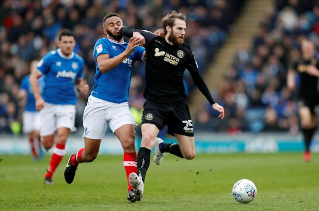 "Soccer Football - League One - Portsmouth vs Wigan Athletic - Fratton Park, Portsmouth, Britain - April 2, 2018 Portsmouth's Anton Walkes in action with Wigan's Nick Powell Action Images/Matthew Childs EDITORIAL USE ONLY. No use with unauthorized audio, video, data, fixture lists, club/league logos or ""live"" services. Online in-match use limited to 75 images, no video emulation. No use in betting, games or single club/league/player publications. Please contact your account representative for further details."