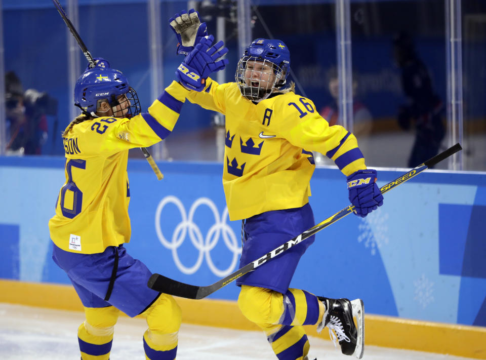 <p>Pernilla Winberg (16) celebrates with Hanna Olsson (26), of Sweden, after scoring a goal against the combined Koreas during the second period of the preliminary round of the women's hockey game at the 2018 Winter Olympics in Gangneung, South Korea, Monday, Feb. 12, 2018. (AP Photo/Julio Cortez) </p>
