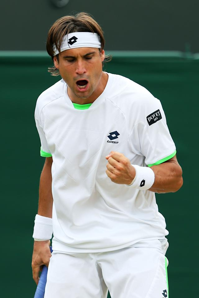 LONDON, ENGLAND - JULY 01: David Ferrer of Spain celebrates a point during the Gentlemen's Singles fourth round match against Ivan Dodig of Croatia on day seven of the Wimbledon Lawn Tennis Championships at the All England Lawn Tennis and Croquet Club on July 1, 2013 in London, England. (Photo by Julian Finney/Getty Images)