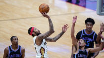New Orleans Pelicans forward Brandon Ingram (14) shoots over Sacramento Kings guard Tyrese Haliburton, right, in the second half of an NBA basketball game in New Orleans, Monday, April 12, 2021. The Pelicans won 117-110. (AP Photo/Gerald Herbert)