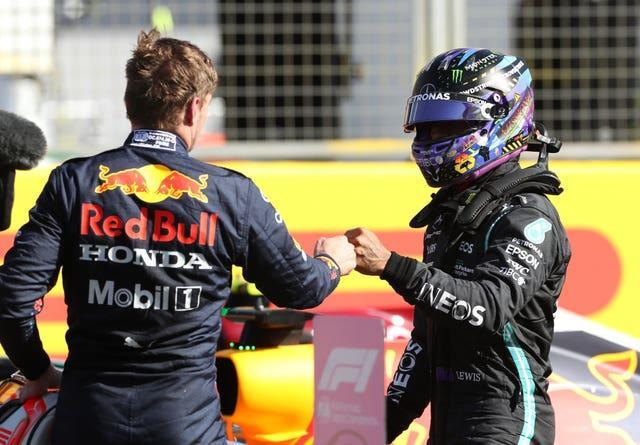 Max Verstappen (left) bumps fists with Lewis Hamilton after the Sprint