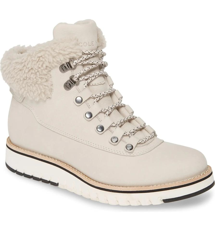 "<p>We love these cozy yet practical <product href=""https://www.nordstrom.com/s/cole-haan-grandexplore-genuine-shearling-trim-waterproof-hiker-boot-women/4774722?origin=category-personalizedsort&amp;breadcrumb=Home%2FWomen%2FShoes%2FBoots&amp;color=pumice%20stone%20nubuck"" target=""_blank"" class=""ga-track"" data-ga-category=""internal click"" data-ga-label=""https://www.nordstrom.com/s/cole-haan-grandexplore-genuine-shearling-trim-waterproof-hiker-boot-women/4774722?origin=category-personalizedsort&amp;breadcrumb=Home%2FWomen%2FShoes%2FBoots&amp;color=pumice%20stone%20nubuck"" data-ga-action=""body text link"">Cole Haan GrandExpløre Genuine Shearling Trim Waterproof Hiker Boot</product> ($200).</p>"