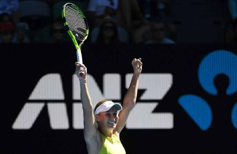 Denmark's Caroline Wozniacki produced a great escape against little-known Croat Jana Fett, rallying from 5-1 down in an epic third set to to keep her dream of a first Grand Slam title alive 3-6, 6-2, 7-5