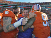 Clemson head coach Dabo Swinney celebrates with Spencer Region, left, and Corey Crawford during the second half of an NCAA college football game against South Carolina in Clemson, S.C., Saturday, Nov. 29, 2014. Clemson won 35-17. (AP Photo/Richard Shiro)