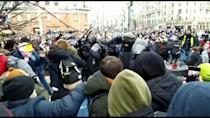 Officers detain protesters at a demonstration in Moscow in support of prominent Kremlin critic Alexei Navalny
