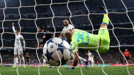 Real Madrid's Karim Benzema scores their first goal