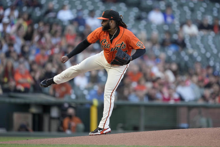 San Francisco Giants starting pitcher Johnny Cueto watches a throw to a San Francisco Giants batter during the first inning of a baseball game Friday, June 18, 2021, in San Francisco. (AP Photo/Tony Avelar)