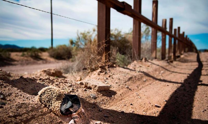 The US-Mexico border fence outside Lukeville, Arizona. Volunteers are said to have found hundreds of water gallons vandalised in a patch of Sonoran desert.