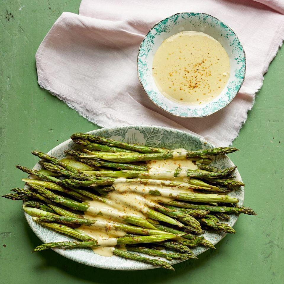 "<p>The secret to nailing this hollandaise sauce is to take your time drizzling in the melted butter. It'll come together eventually—and taste phenomenal.</p><p><strong><a href=""https://www.thepioneerwoman.com/food-cooking/recipes/a35584543/roasted-asparagus-with-cajun-hollandaise-recipe/"" rel=""nofollow noopener"" target=""_blank"" data-ylk=""slk:Get the recipe"" class=""link rapid-noclick-resp"">Get the recipe</a>.</strong></p><p><a class=""link rapid-noclick-resp"" href=""https://go.redirectingat.com?id=74968X1596630&url=https%3A%2F%2Fwww.walmart.com%2Fbrowse%2Fhome%2Fserveware%2Fthe-pioneer-woman%2F4044_623679_639999_2347672&sref=https%3A%2F%2Fwww.thepioneerwoman.com%2Ffood-cooking%2Fmeals-menus%2Fg35589850%2Fmothers-day-dinner-ideas%2F"" rel=""nofollow noopener"" target=""_blank"" data-ylk=""slk:SHOP SERVEWARE"">SHOP SERVEWARE</a></p>"