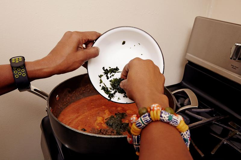 """Here, Seriki adds bitter leaf, a traditional Nigerian herb, to her obe ata—the """"mother sauce"""" of West African cooking."""