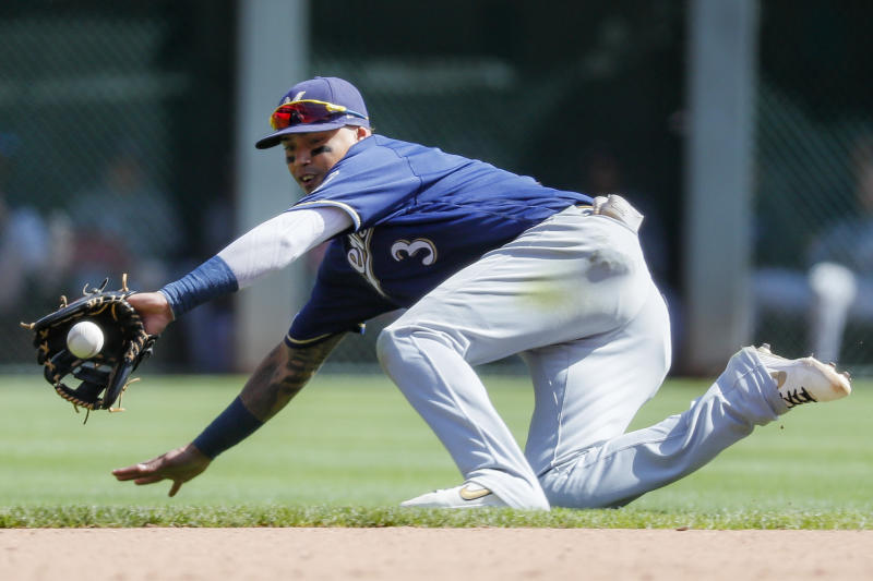 Milwaukee Brewers shortstop Orlando Arcia fields a ground ball hit by Cincinnati Reds' Aristides Aquino before throwing to first for the out in the seventh inning of a baseball game, Thursday, Sept. 26, 2019, in Cincinnati. (AP Photo/John Minchillo)