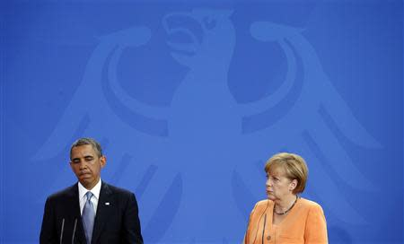 File photo of U.S. President Obama and German Chancellor Merkel holding a joint news conference in Berlin
