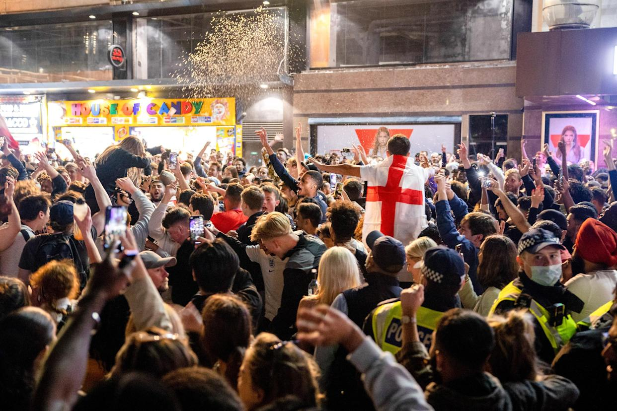 Crowds of jubilant football fans gather at Leicester Square to celebrate the victory. Thousands of England football fans gathered at central London to celebrate the triumph against the Denmark team in the semifinal match. England beat Denmark 2-1. (Photo by Hesther Ng / SOPA Images/Sipa USA)