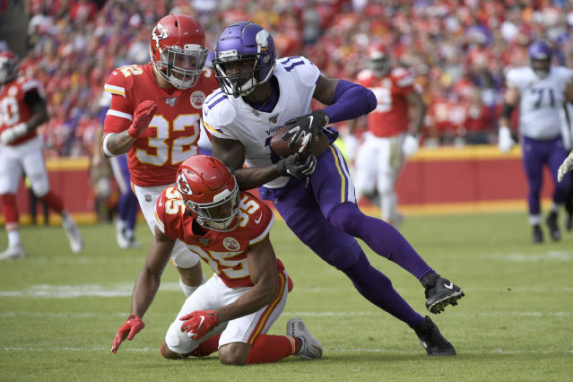 Minnesota Vikings wide receiver Laquon Treadwell (11) runs against Kansas City Chiefs cornerback Charvarius Ward (35) and safety Tyrann Mathieu (32) during the first half of an NFL football game in Kansas City, Mo., Sunday, Nov. 3, 2019. (AP Photo/Reed Hoffmann)