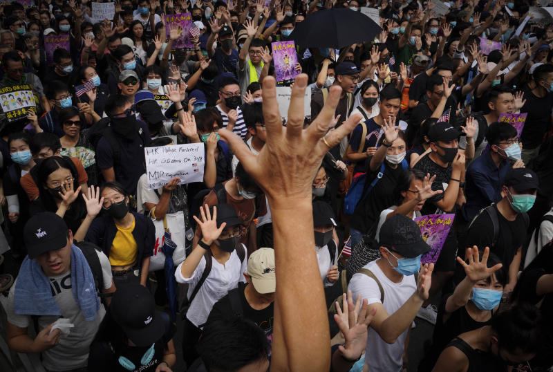Protesters shows their palms with five fingers open, signifying the five demands of protesters, as they march from Chater Garden to the U.S. consulate in Hong Kong, Sunday, Sept. 8, 2019. Demonstrators in Hong Kong plan to march to the U.S. Consulate on Sunday to drum up international support for their protest movement, a day after attempts to disrupt transportation to the airport were thwarted by police. (AP Photo/Kin Cheung)