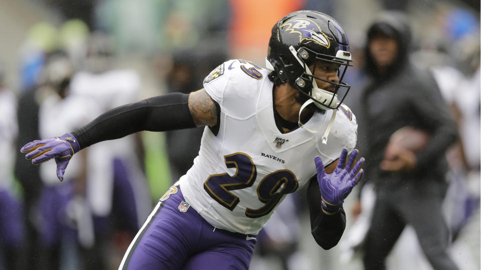 Baltimore Ravens free safety Earl Thomas runs on the field during warmups before an NFL football game against the Seattle Seahawks, Sunday, Oct. 20, 2019, in Seattle. (AP Photo/John Froschauer)