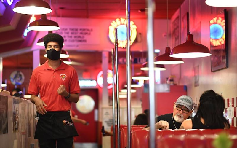 VENTURA, CALIFORNIA MAY 23, 2020-Diners enjoy a meal at BusyBee 50's Cafe in Ventura Saturday. The county lifted a lockdown for sit down dining at all restaurants.(Wally Skalij/Los Angeles Times)