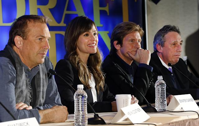 "Actors, from left, Kevin Costner, Jennifer Garner, Denis Leary and director Ivan Reitman appear at a news conference for the movie ""Draft Day"" in New York on Friday, Jan. 31, 2014. The Seattle Seahawks play the Denver Broncos on Sunday at the stadium in the NFL Super Bowl XLVIII football game. (AP Photo/Paul Sancya)"