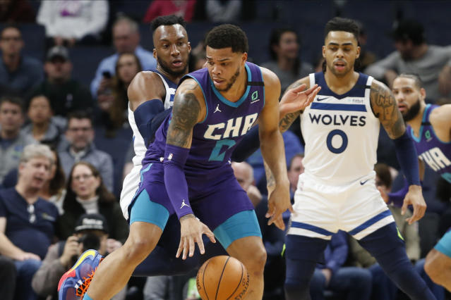Charlotte Hornets' Miles Bridges, center, controls the ball in front of Minnesota Timberwolves' Josh Okogie, left, and D'Angelo Russell during the first half of an NBA basketball game Wednesday, Feb. 12, 2020, in Minneapolis. (AP Photo/Jim Mone)