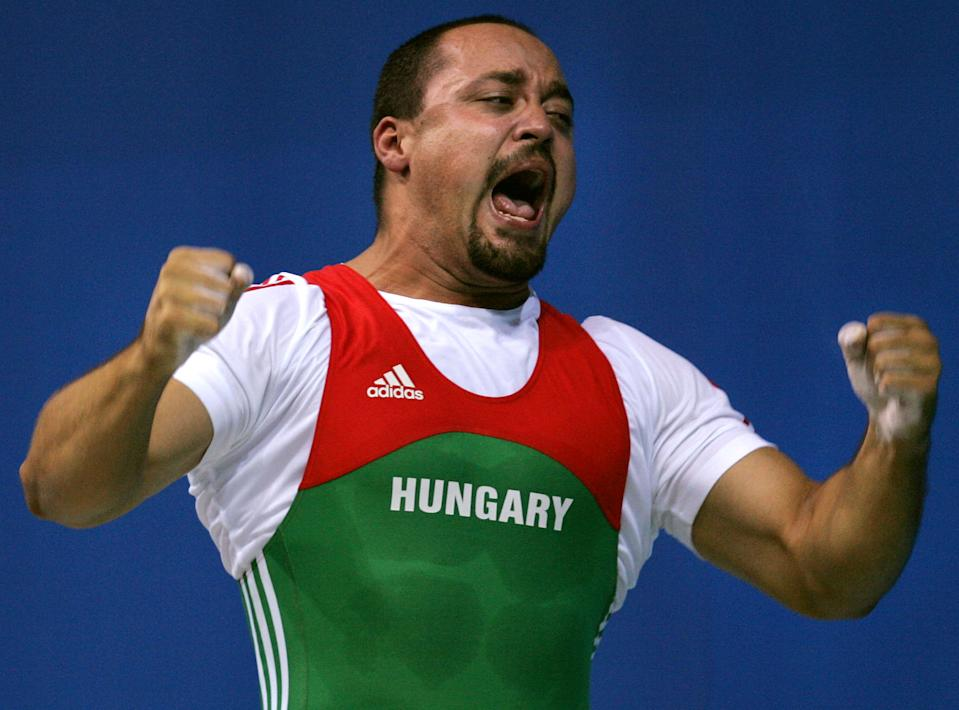 Hungarian weightlifter Ferenc Gyurkovics earned the silver medal in the 105-kilogram class at the 2004 Athens Games, but he later tested positive for an anabolic steroid. (AP Photo/Charles Krupa)