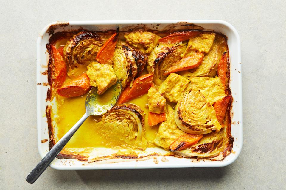"""For this easy vegetarian dinner, we roast thick wedges of <a href=""""https://www.epicurious.com/recipes-menus/17-of-the-best-cabbage-recipes-gallery?mbid=synd_yahoo_rss"""" rel=""""nofollow noopener"""" target=""""_blank"""" data-ylk=""""slk:cabbage"""" class=""""link rapid-noclick-resp"""">cabbage</a>, carrots, and <a href=""""https://www.epicurious.com/ingredients/terrific-tofu-recipes-gallery?mbid=synd_yahoo_rss"""" rel=""""nofollow noopener"""" target=""""_blank"""" data-ylk=""""slk:tofu"""" class=""""link rapid-noclick-resp"""">tofu</a> in a spiced coconut milk sauce until they're wonderfully softened and caramelized. <a href=""""https://www.epicurious.com/recipes/food/views/coconut-cabbage-and-tofu-with-lemongrass-and-ginger?mbid=synd_yahoo_rss"""" rel=""""nofollow noopener"""" target=""""_blank"""" data-ylk=""""slk:See recipe."""" class=""""link rapid-noclick-resp"""">See recipe.</a>"""