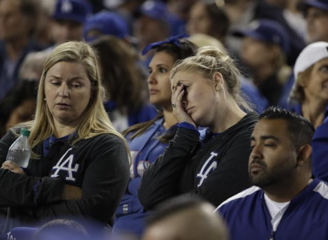 Dodgers fans watch during the eighth inning of Game 7 of the World Series. (AP)