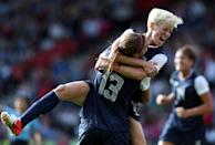 Alex Morgan #13 of USA is congratulated by Megan Rapinoe after scoring during the Women's Football first round Group G Match of the London 2012 Olympic Games between United States and France, at Hampden Park on July 25, 2012 in Glasgow, Scotland. (Photo by Stanley Chou/Getty Images)