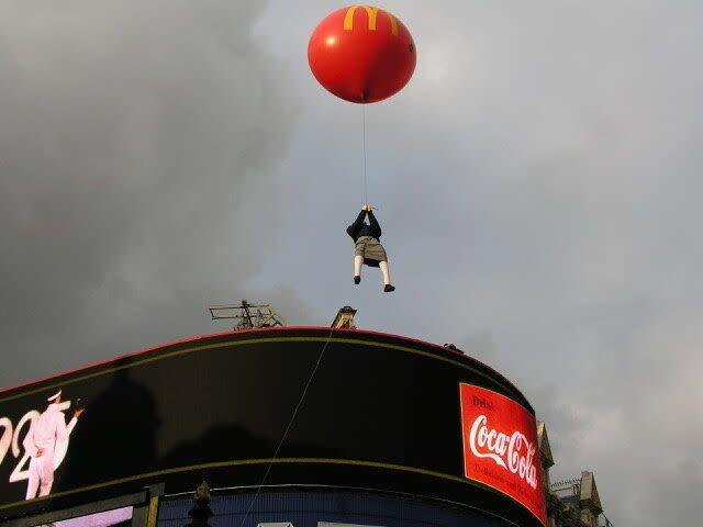 Banksy's floating girl was later struck by a bus. (Photo: Steve Lazarides)