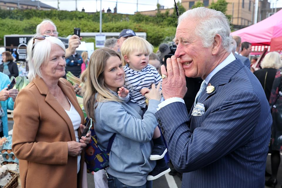 BANGOR, NORTHERN IRELAND - MAY 19: Prince Charles, Prince of Wales speaks with stall holders as he visits Bangor open air market with Camilla, Duchess of Cornwall on May 19, 2021 in Bangor, Northern Ireland. (Photo by Chris Jackson - Pool/Getty Images)