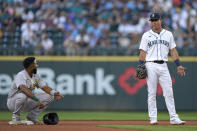 Oakland Athletics' Elvis Andrus, left, talks with Seattle Mariners second baseman Dylan Moore after Andrus reached second during the third inning of a baseball game Saturday, July 24, 2021, in Seattle. (AP Photo/Ted S. Warren)