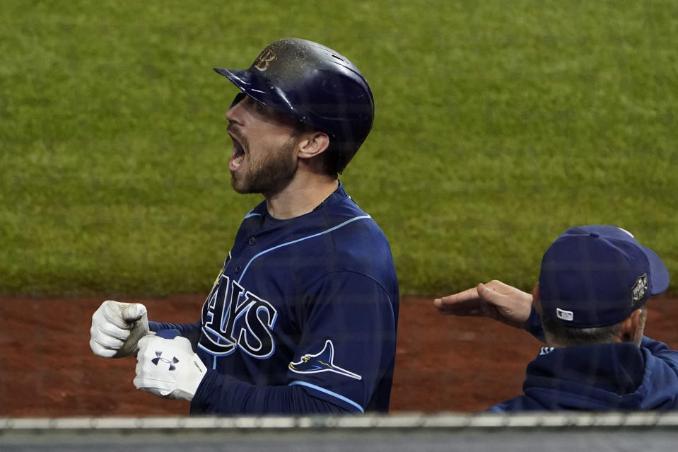 Tampa Bay Rays' Brandon Lowe celebrates his three-run home run against the Los Angeles Dodgers during the sixth inning in Game 4 of the baseball World Series Saturday, Oct. 24, 2020, in Arlington, Texas. (AP Photo/Tony Gutierrez)