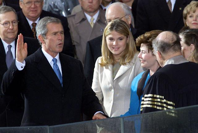George W. Bush takes the oath of office from Chief Justice William Rehnquist to become the 43rd president Saturday, Jan. 20, 2001, in Washington. (AP Photo/Doug Mills)