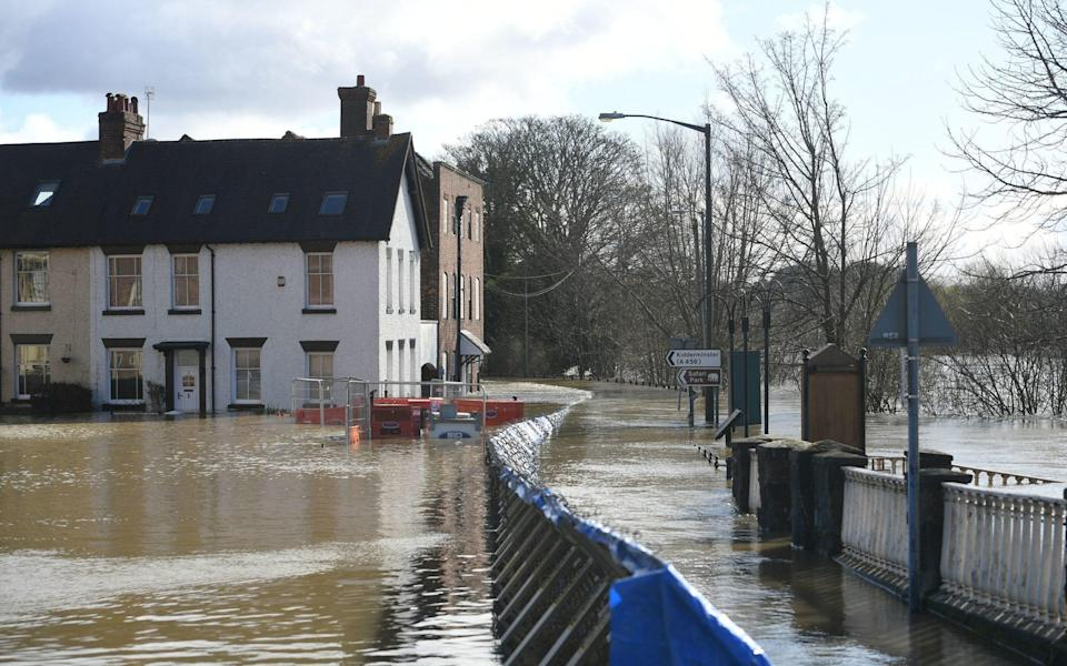 The temporary flood defences in Bewdley, Worcestershire. Bewdley, which has been washed out for three years running, is set to see £6.2 million spent on a permanent flood defence - Joe Giddens