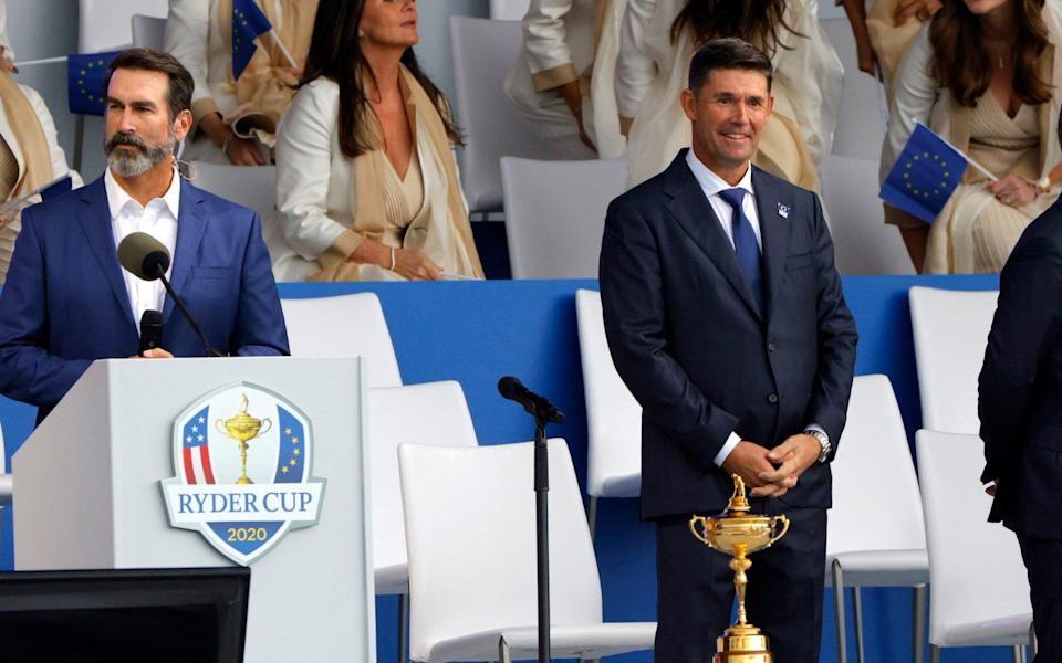 Golf - The 2020 Ryder Cup - Whistling Straits, Sheboygan, Wisconsin, U.S. - September 23, 2021 Team Europe captain Padraig Harrington, host Rob Riggle with the Ryder Cup trophy during the opening ceremony - REUTERS/BRIAN SNYDER