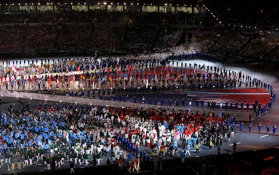 Athletes enter the stadium during the Closing Ceremony on Day 16 of the London 2012 Olympic Games at Olympic Stadium on August 12, 2012 in London, England. (Photo by Clive Brunskill/Getty Images)