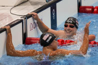 Katie Ledecky, right, of the United States, celebrates after winning the women's 1500-meters freestyle final with Erica Sullivan, of the United States, at the 2020 Summer Olympics, Wednesday, July 28, 2021, in Tokyo, Japan. (AP Photo/Charlie Riedel)