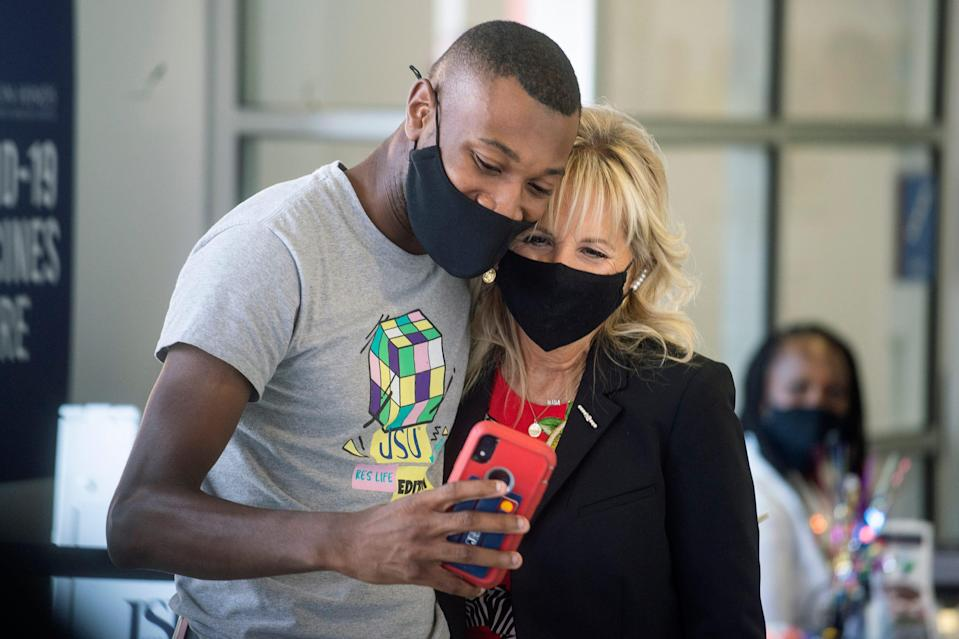 First Lady Jill Biden, right, takes a photo with Bryan Wilson after receiving his COVD-19 vaccination during the First Lady's visit at Jackson State University in Jackson, Miss., Tuesday, June 22, 2021.