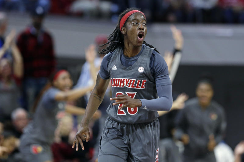Louisville guard Jazmine Jones (23) reacts following a 3-point basket against North Carolina State during the second half of an NCAA college basketball game in Raleigh, N.C., Thursday, Feb. 13, 2020. (AP Photo/Gerry Broome)