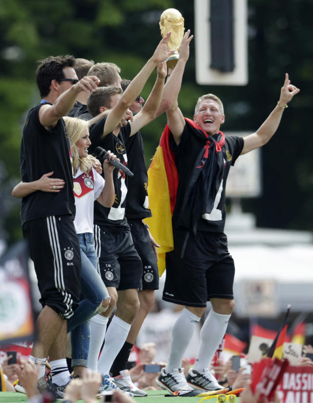 Singer Helene Fischer, second left, performs during a fan party after the arrival of the German national soccer team in Berlin Tuesday, July 15, 2014. Germany beat Argentina 1-0 on Sunday to win its fourth World Cup title. (AP Photo/Petr David Josek)