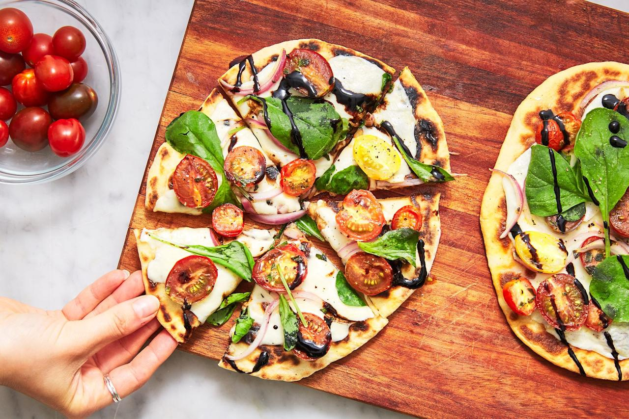 "<p>What's the difference between a pizza and a flatbread? I'm so glad you asked. The latter is supposed to be made with <a href=""https://www.palmbeachdailynews.com/article/20141127/NEWS/311279922"" target=""_blank"">unleavened dough</a>, though that's not really a hard-and-fast rule anymore. Typically, flatbreads have less sauce, cheese, and toppings than a traditional pizza. So when you need something lighter for dinner, consider one of these delicious flatbreads. Bonus: Flatbreads work as a sandwich wrap or breakfast base, too. If you're loyal to team pizza, check out all our best <a href=""https://www.delish.com/cooking/g269/homemade-pizza-recipes/"" target=""_blank"">homemade pizza recipes here</a>.</p>"