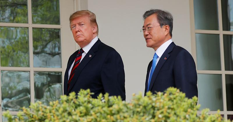 President Donald Trump walks with South Korea's President Moon Jae-in at the White House in Washington, U.S., April 11, 2019.