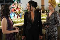 <p>Kat perfected the art of cocktail-party dressing in a suit and chain-drop earrings. </p>