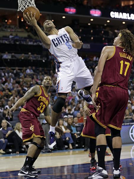 Charlotte Bobcats' Gerald Henderson (9) drives between Cleveland Cavaliers' Anderson Varejao (17) and Alonzo Gee (33) during the first half of an NBA basketball game in Charlotte, N.C., Friday, Nov. 1, 2013. (AP Photo/Chuck Burton)