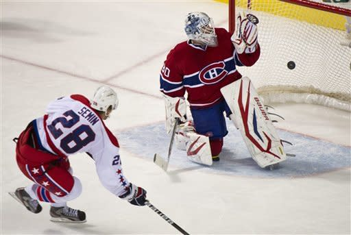 Washington Capitals' Alexander Semin scores on a penalty shot past Montreal Canadiens goalie Peter Budaj during third period NHL hockey action, Saturday, Feb. 4, 2012 in Montreal. (AP Photo/The Canadian Press, Paul Chiasson)