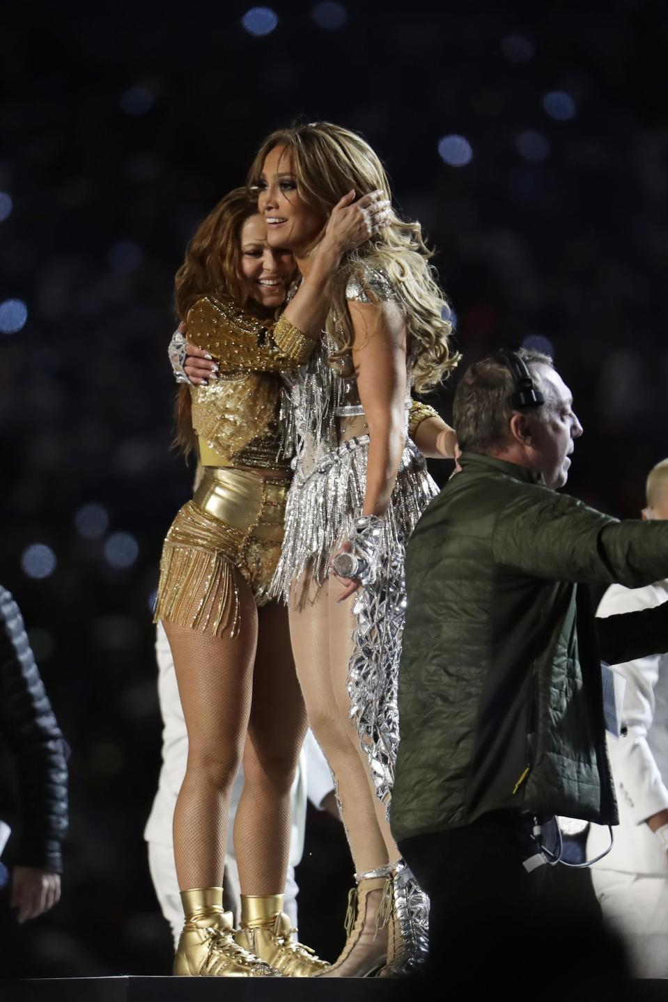 Shakira, left, hugs Jennifer Lopez after performing during halftime of the NFL Super Bowl 54 football game between the Kansas City Chiefs and the San Francisco 49ers Sunday, Feb. 2, 2020, in Miami Gardens, Fla. (AP Photo/Lynne Sladky)