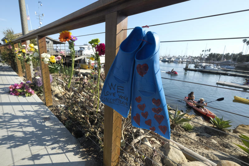 A pair of fines and flowers are placed at outside of the Sea Landing at Santa Barbara Harbor in Santa Barbara , Calif. Monday, Sept. 2, 2019. (Photo: Ringo H.W. Chiu/AP)