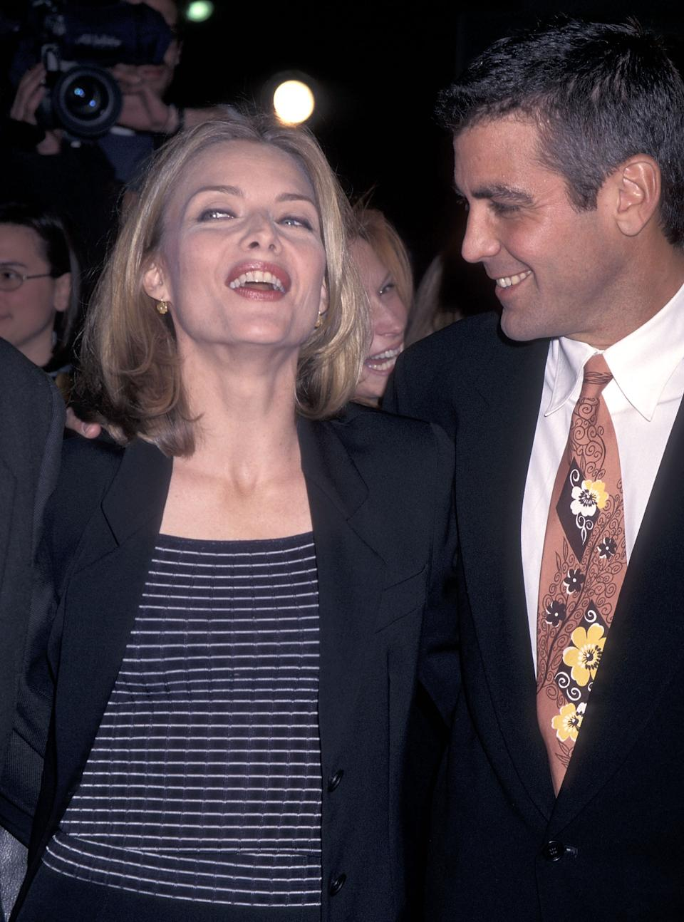 "WESTWOOD, CA - DECEMBER 17:   Actress Michelle Pfeiffer and actor George Clooney attend the ""One Fine Day"" Westwood Premiere on December 17, 1996 at Mann's Chinese Theatre in Westwood, California. (Photo by Ron Galella, Ltd./Ron Galella Collection via Getty Images)"