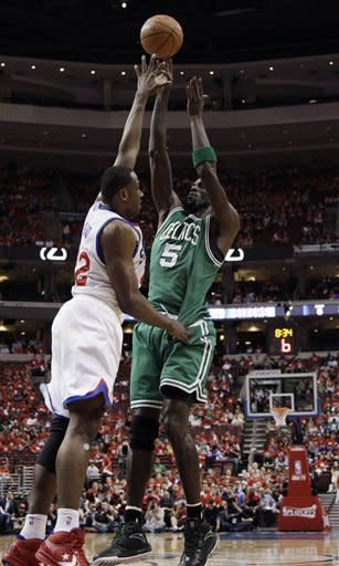 Boston Celtics' Kevin Garnett (5) shoots against Philadelphia 76ers' Elton Brand during the first half of Game 3 of an NBA basketball Eastern Conference semifinal playoff series, Wednesday, May 16, 2012, in Philadelphia. (AP Photo/Matt Slocum)